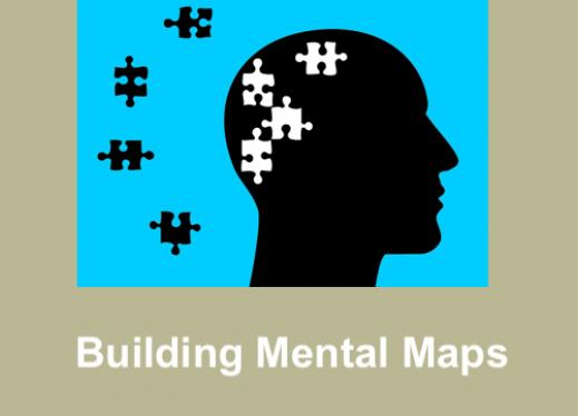 "Silhouette of head with puzzle pieces outside and inside the head and text, ""Building Mental Maps""."