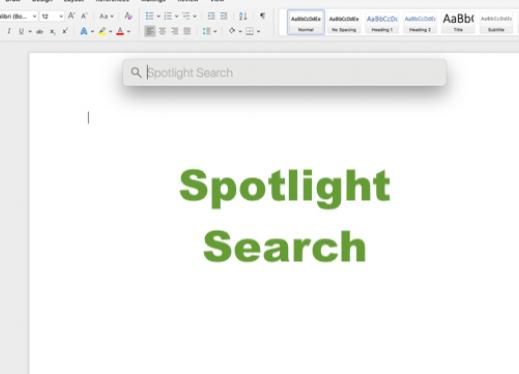 MacBook screen with a blank Word file open and the Spotlight Search edit box visible on the top center of the screen and text.