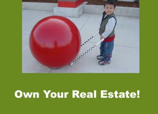 """Smiling 4year old with precane bumped up to Red Cement Ball at Target. Text, """"Own your Real Estate!"""""""