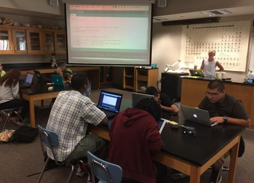 High school students in an engineering class using various devices with magnification and screen readers.