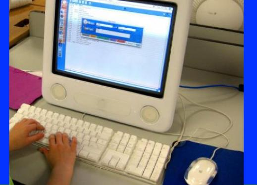 A child's hands are shown working on a computer.