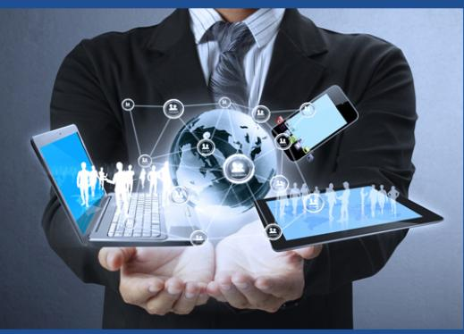 Young man in business suit holding in his hands a rendering of the world with lines to a computer, tablet, phone, and 3D people