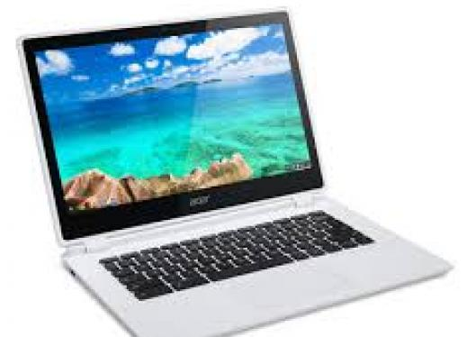 Image of an open Chromebook with the home screen showing.