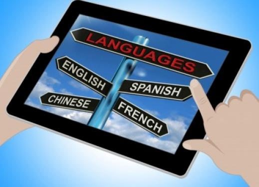 Tablet showing a Languages sign post pointing the way to English, Spanish, Chinese and French