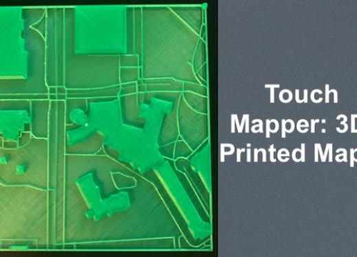 "3D printed map of NIU with sidewalks, roads and buildings around Graham Hall and text, ""Touch Mapper: 3D Printed Maps"""