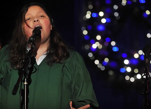 The author singing at a Christmas concert