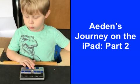 image of Aeden concentrating on VoiceOver with his finger on the braille display's joystick.