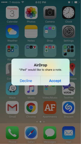 Screenshot of iOS home page with accept or decline Airdrop menu displayed