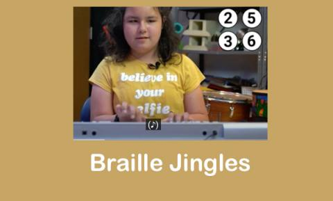 """Screenshot of Lyla playing the G song with dots 2, 3, 5, 6 on the screen and text, """"Braille Jingles"""""""