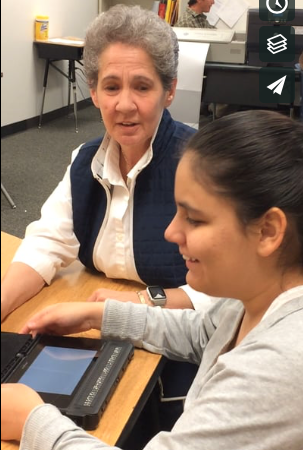 Marsha Bork, TVI, introducing Danna, 8th grade student, to BrailleNote Touch.