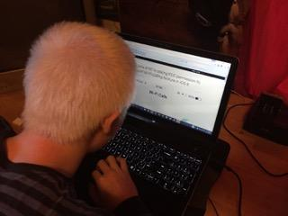 Elijah using magnification on a Mac computer