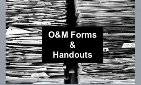 """Two stacks of paperwork with text, """"O&M Forms & Handouts"""""""