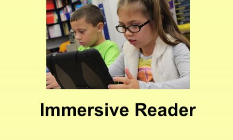 """2 elementary students using tablets and text, """"Immersive Reader"""""""