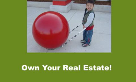 """Smiling 4 year old with precane bumped up to Red Cement Ball at Target. Text, """"Own your Real Estate!"""""""