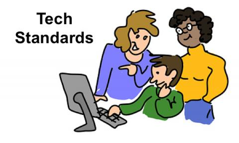 """Cartoon image of two teachers standing behind a student who is using a computer; text: """"Tech Standards"""""""