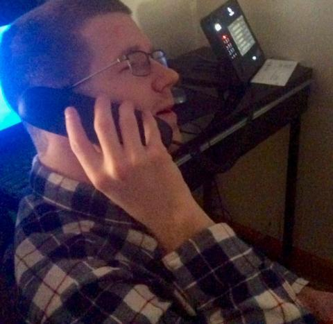A college student speaking on the phone