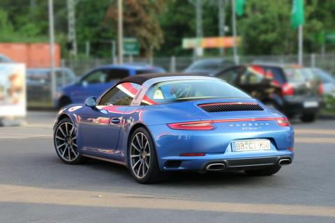 a blue Porsche Targa sports car