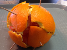 Peeled orange with toothpicks