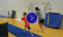 Young child is running in a gym.