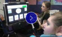 A young student gazing at a computer screen with symbols.