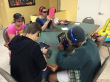 kids playing with electronic games
