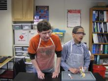 Two boys with visual impairments in science classroom