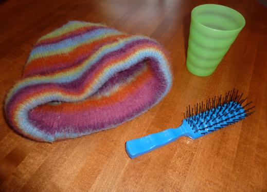 hat, cup and brush