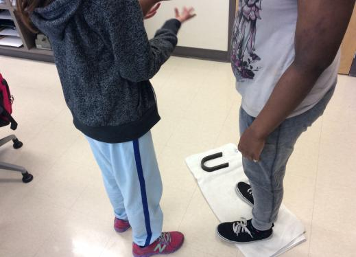 A towel with a magnet on it represent the position during high tide.