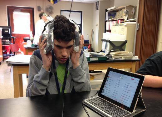 student listening to sound through plastic bags filled with water