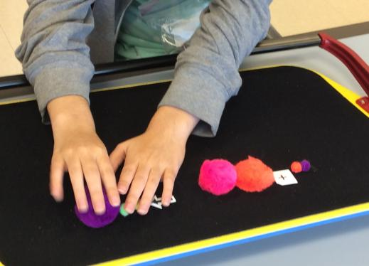 The image is of a student creating the model.