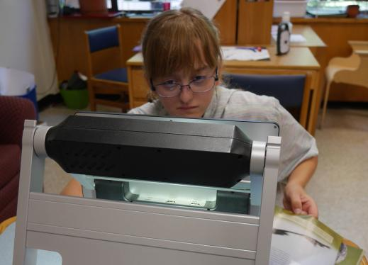 An adolescent girl uses a VisoBook