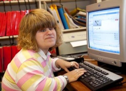 A girl types at a computer
