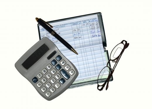 Checkbook recorder, calculator, pen, and glasses