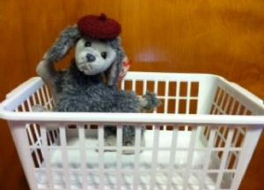 A stuffed dog in a basket