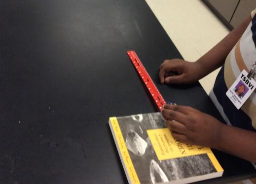 A student using a ruler