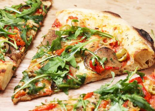 pizza with arugula, cheese, and tomato sauce