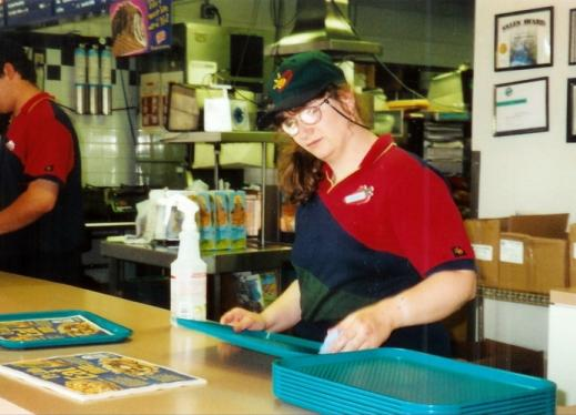 Putting placemats on trays