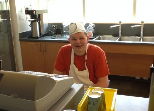 Teenage boy wearing food service cap