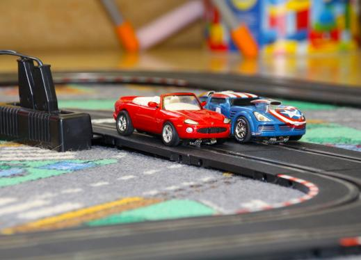 Two toy race cars on a track