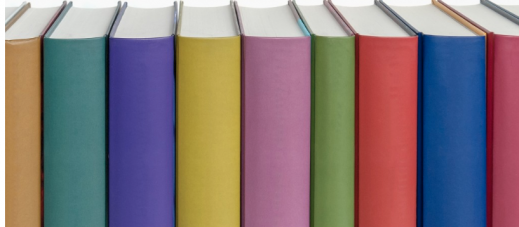 Brightly colored books standing in a row.