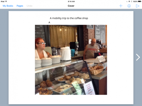 Photo of waitress standing behind the counter at a coffee shop.