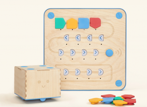 Cubetto - a wooden robot, coding blocks and board, and map - teaches young students the concepts of coding.