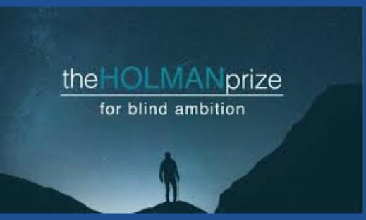The Holman Prize for blind ambition: silhouette of a man with a cane standing on mountain top at dusk.
