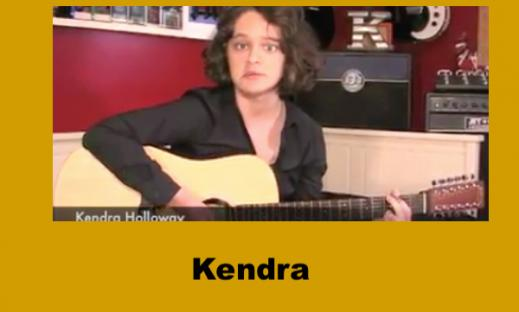 """Photo of 16 year old girl playing a guitar with the text, """"Kendra""""."""