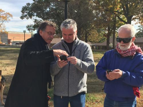 Three COMS using BlindSquare to set POIs on a campus.