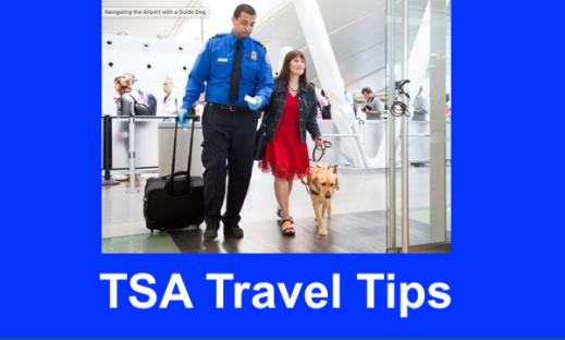 Photo of TSA officer walking beside a blind woman and her guide dog in the airport.