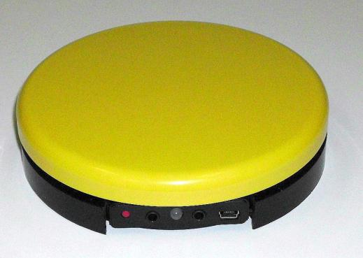 R.J. Cooper Bluetooth Super-Switch, a big yellow switch device, that pairs with tablets.