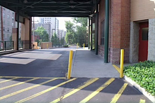 A photo of a road running along a side of a building illustrates some of the challenges a child with CVI might encounter.