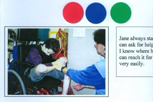 A portfolio shown a blue dot beside a photo of a student getting into his wheelchair.