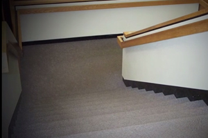 Poorly outlined stairs demonstating am environment not well adapted for visually impaired students.